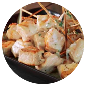 GRILLED SWORDFISH SKEWERS WITH COCONUT, KEY LIME AND GREEN CHILE SAUCE